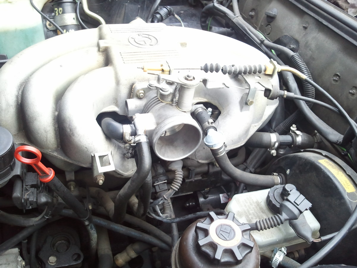 Locate the TPS to the side of the throttle body.