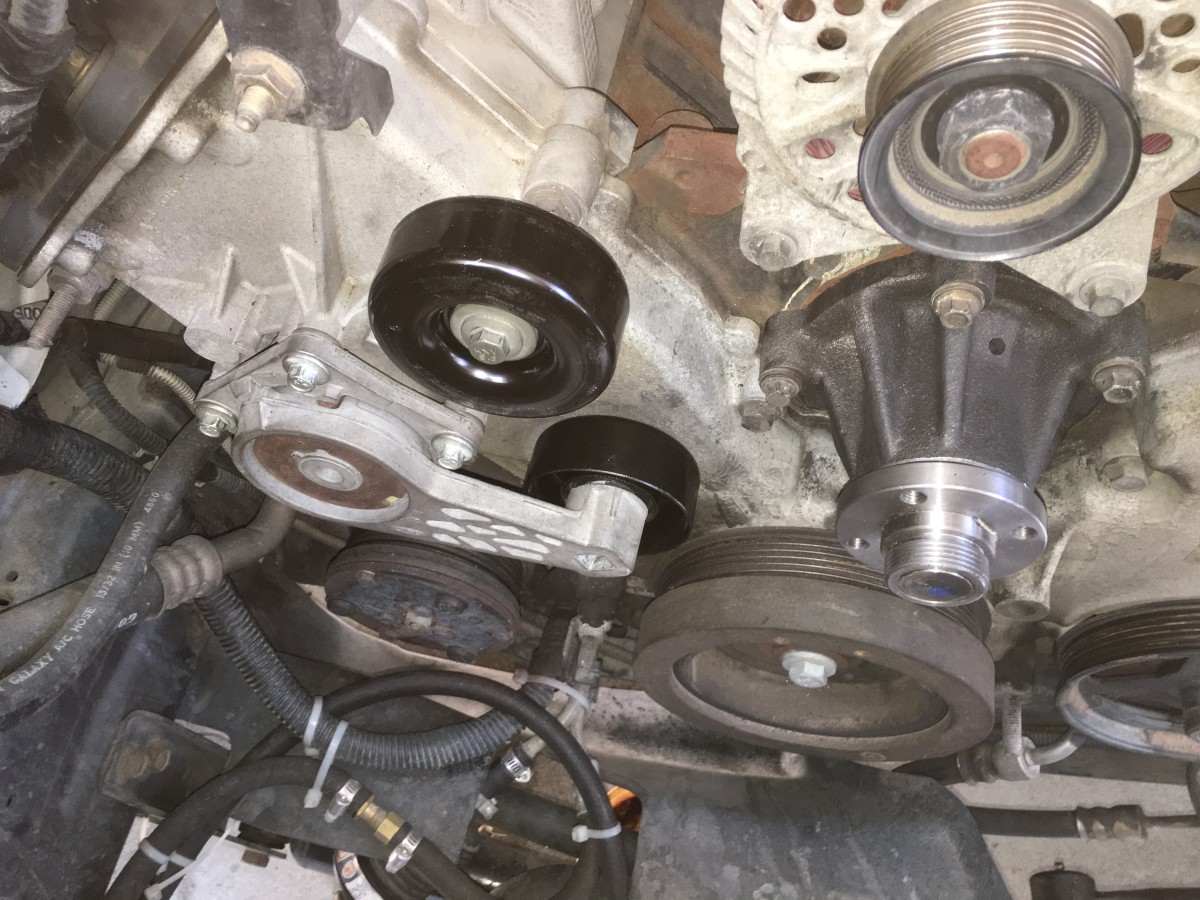 On some vehicles, you need to remove the radiator fan to replace the water pump.