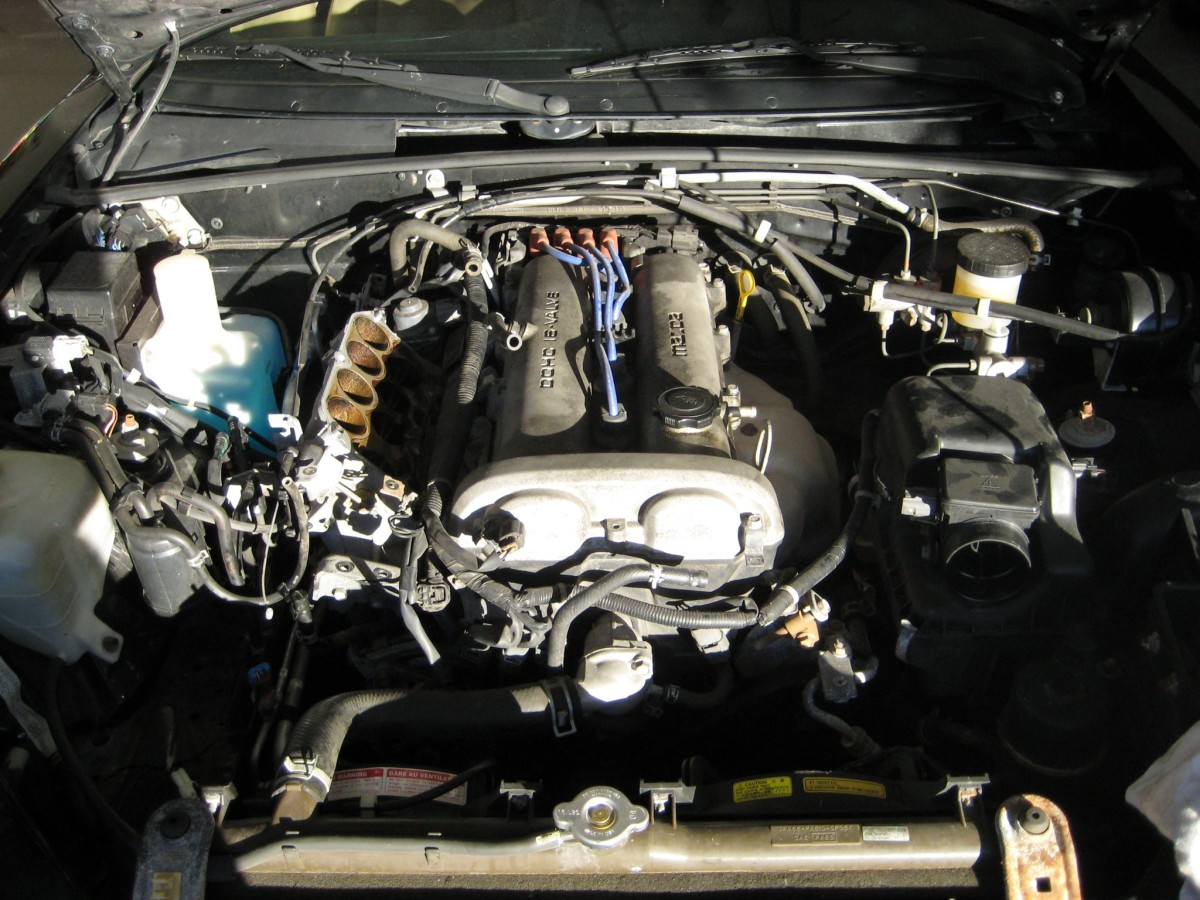 A vacuum hose connects the intake manifold to the brake booster.