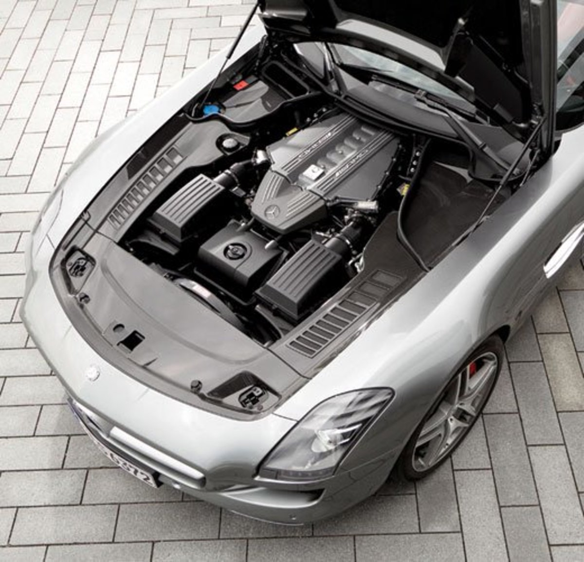 The engine bay of the Mercedes Benz SLS AMG, set back and low, to keep the center of gravity as low as possible in an effort to improve handling.