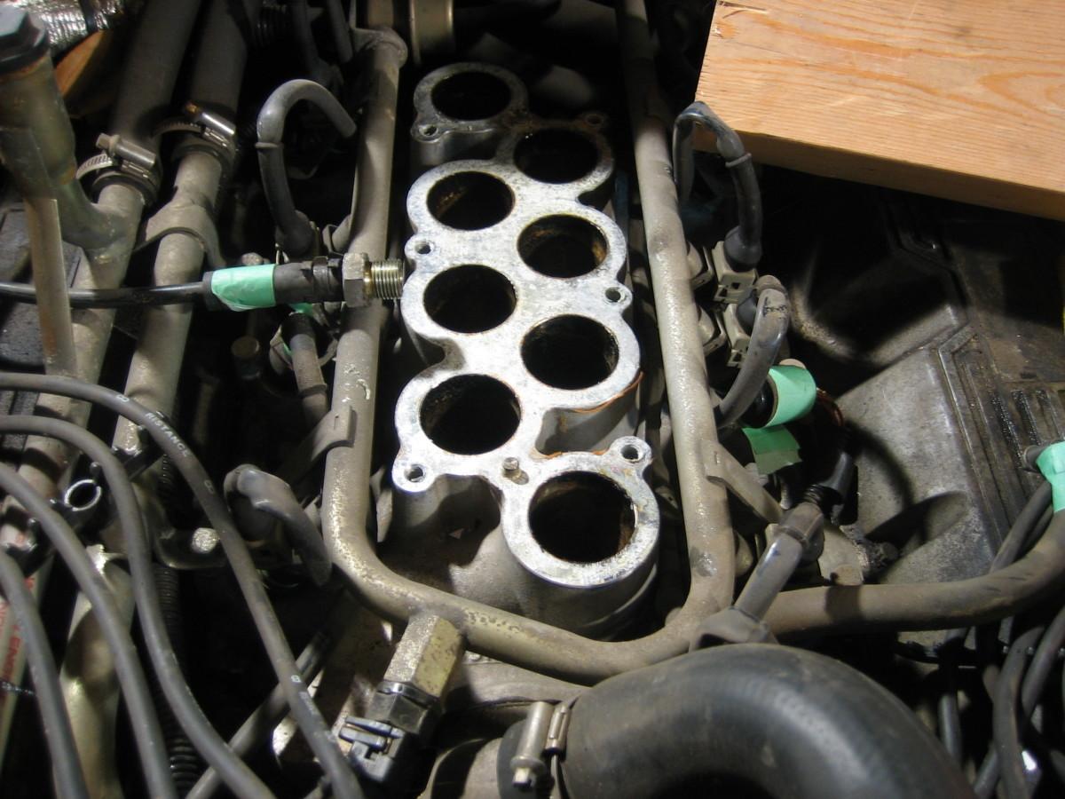 Replace the intake manifold gasket if it develops a vacuum leak.