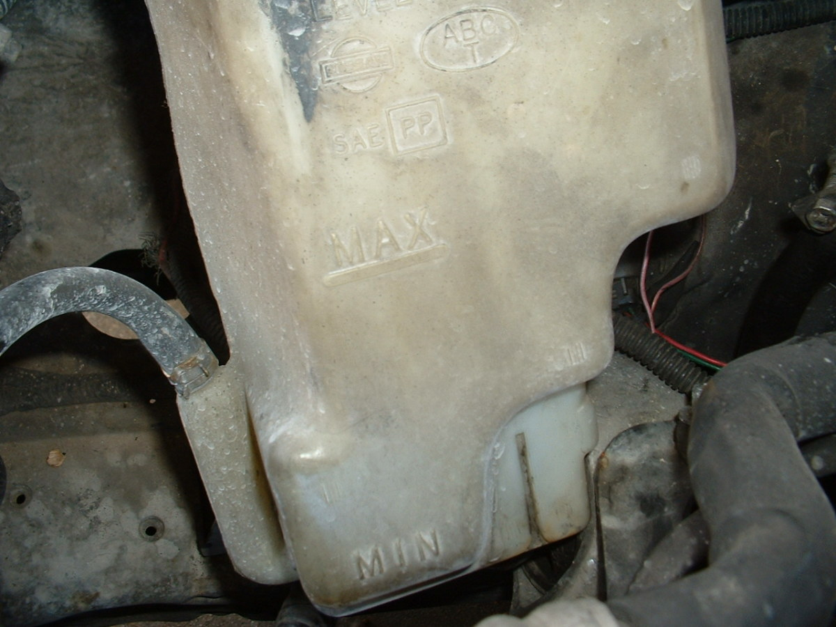 Check for coolant leaks around the coolant reservoir and radiator.
