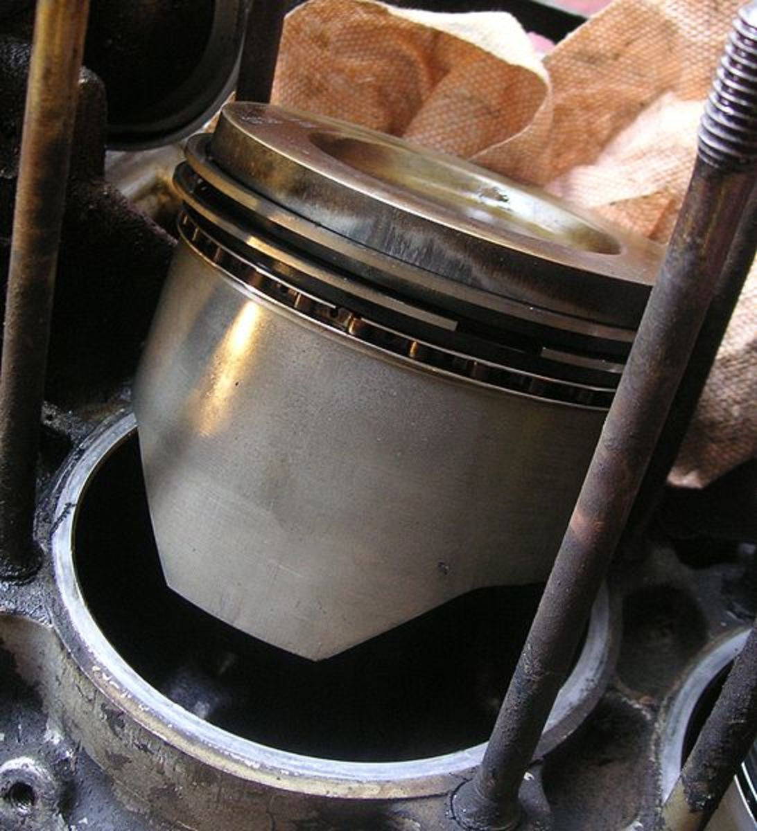 Worn-out piston oil rings will cause oil leaks into the chamber.