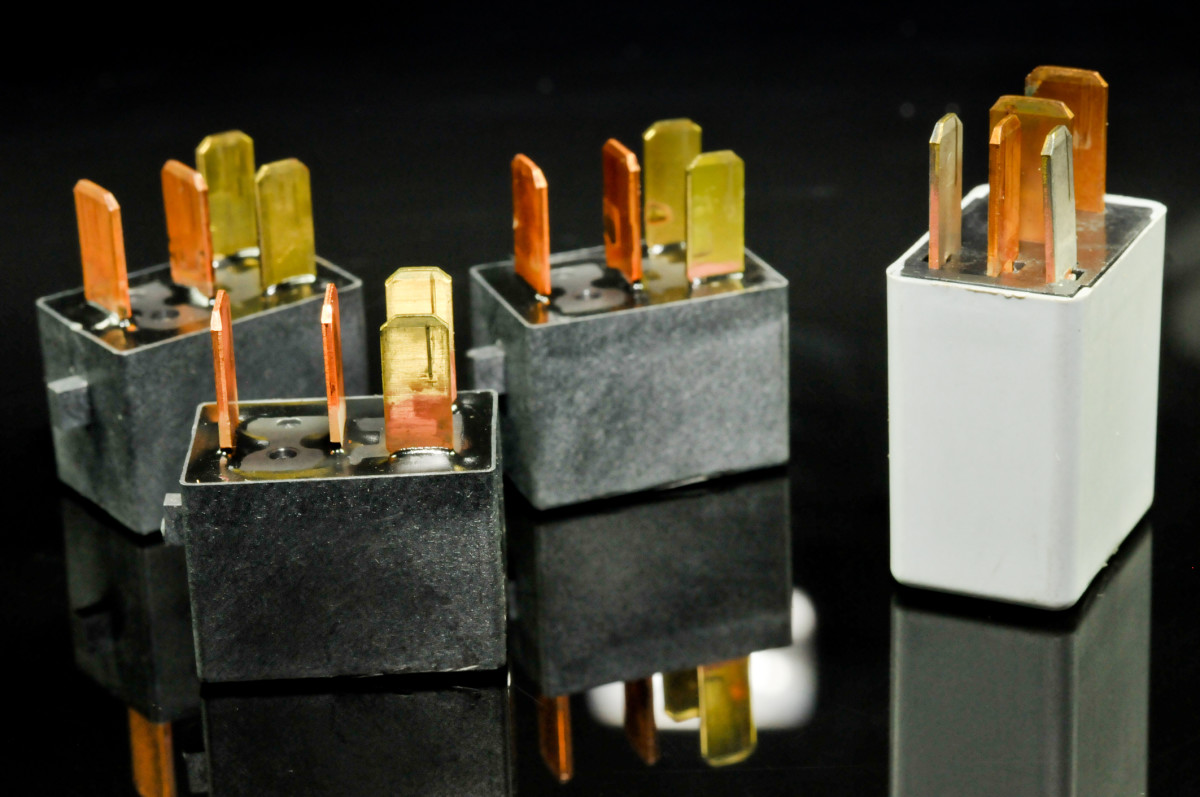 """The typical four-prong relay has two circuits: one light-duty control circuit and one heavy duty """"load"""" or """"work"""" circuit."""