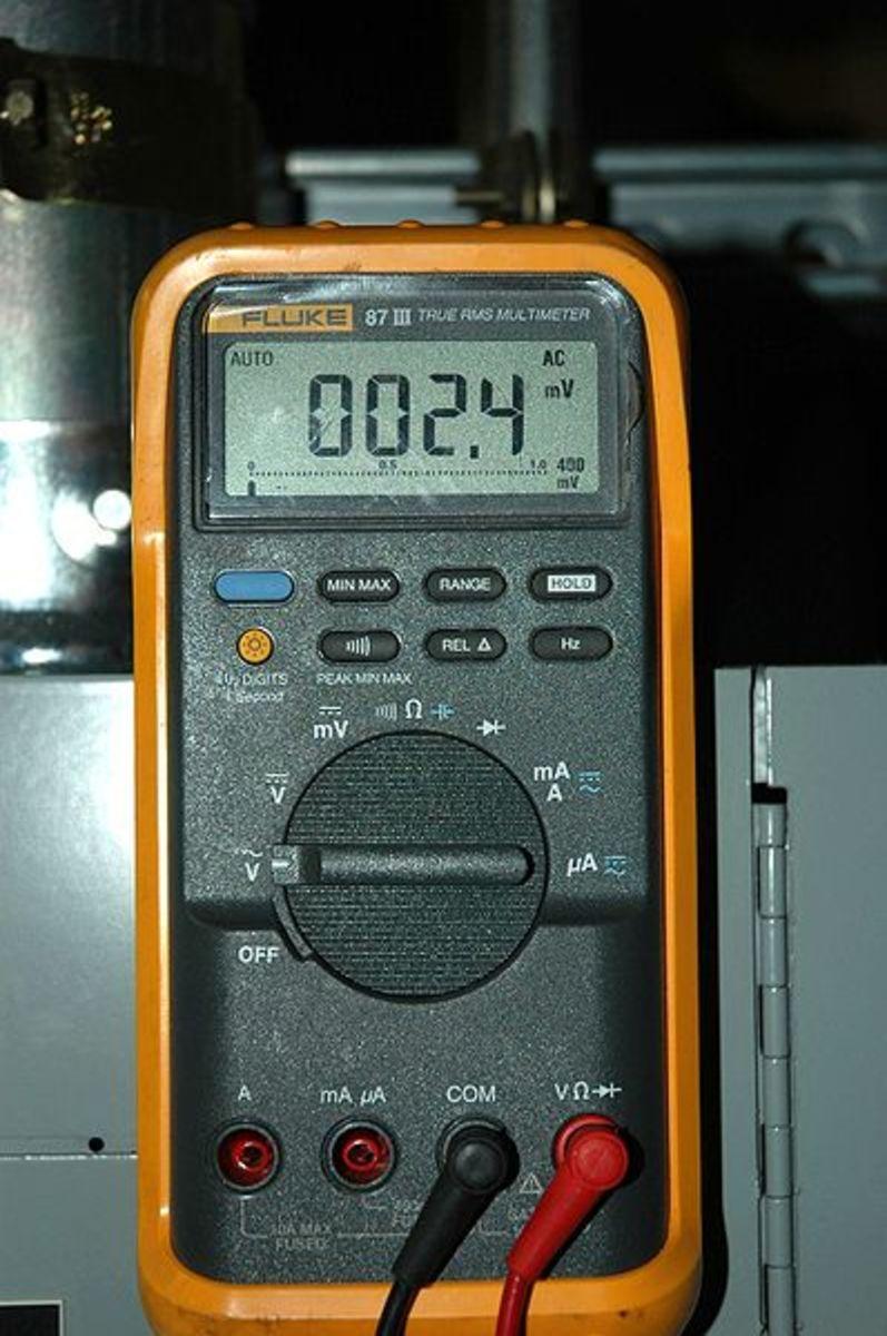Measure system voltage and drop voltages using a digital multimeter.