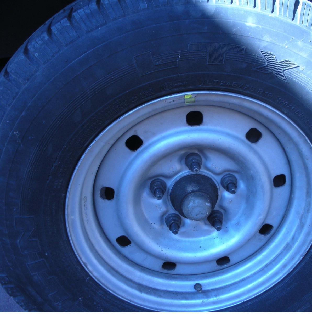 With the spare tire mounted on the truck, the next step is to buy a new tire!