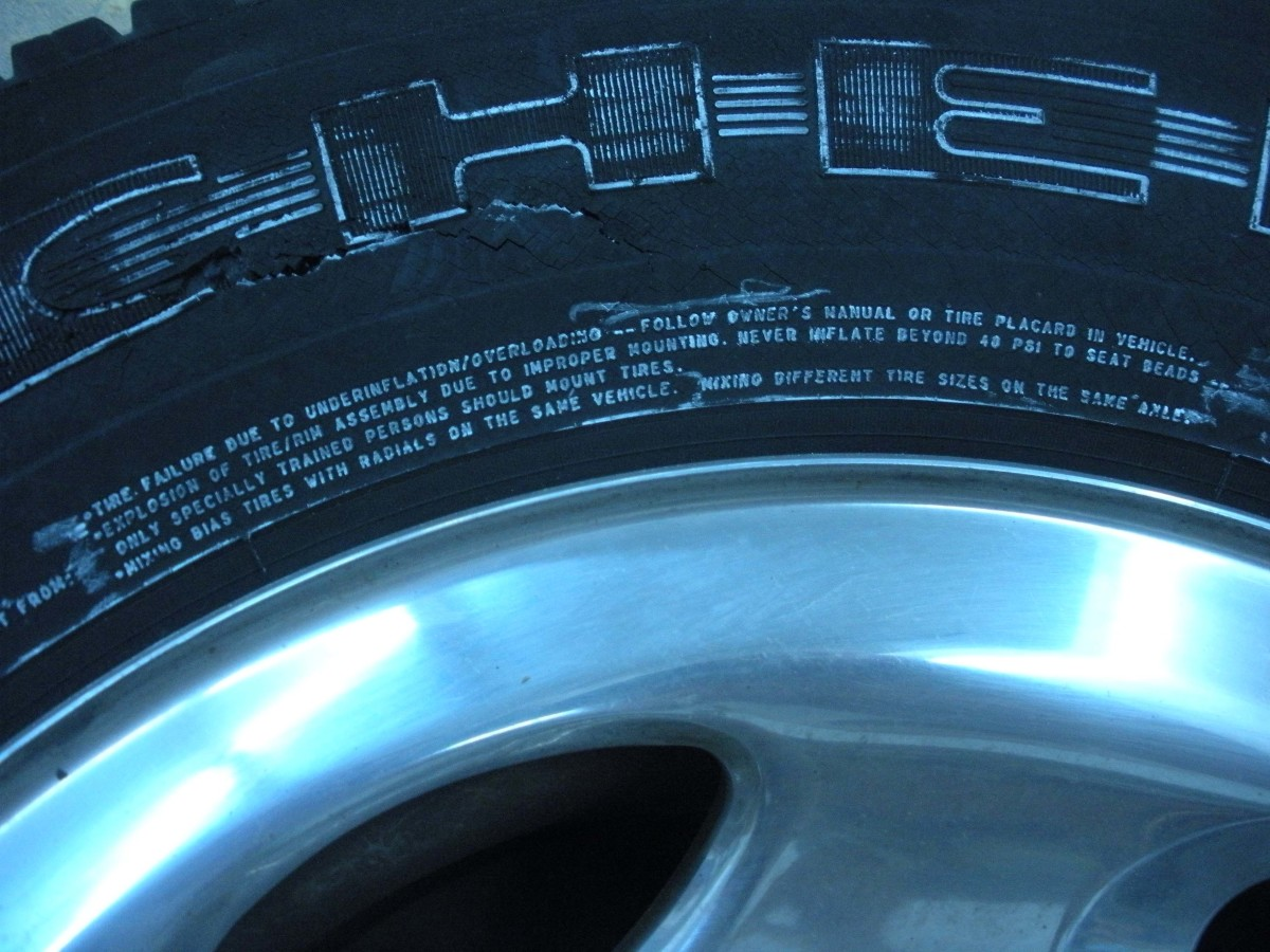 In small print on the tire, it warns against over-inflation, and lists the dangers.  Even with an extreme close up, and highlighted in white chalk, it is hard to read.