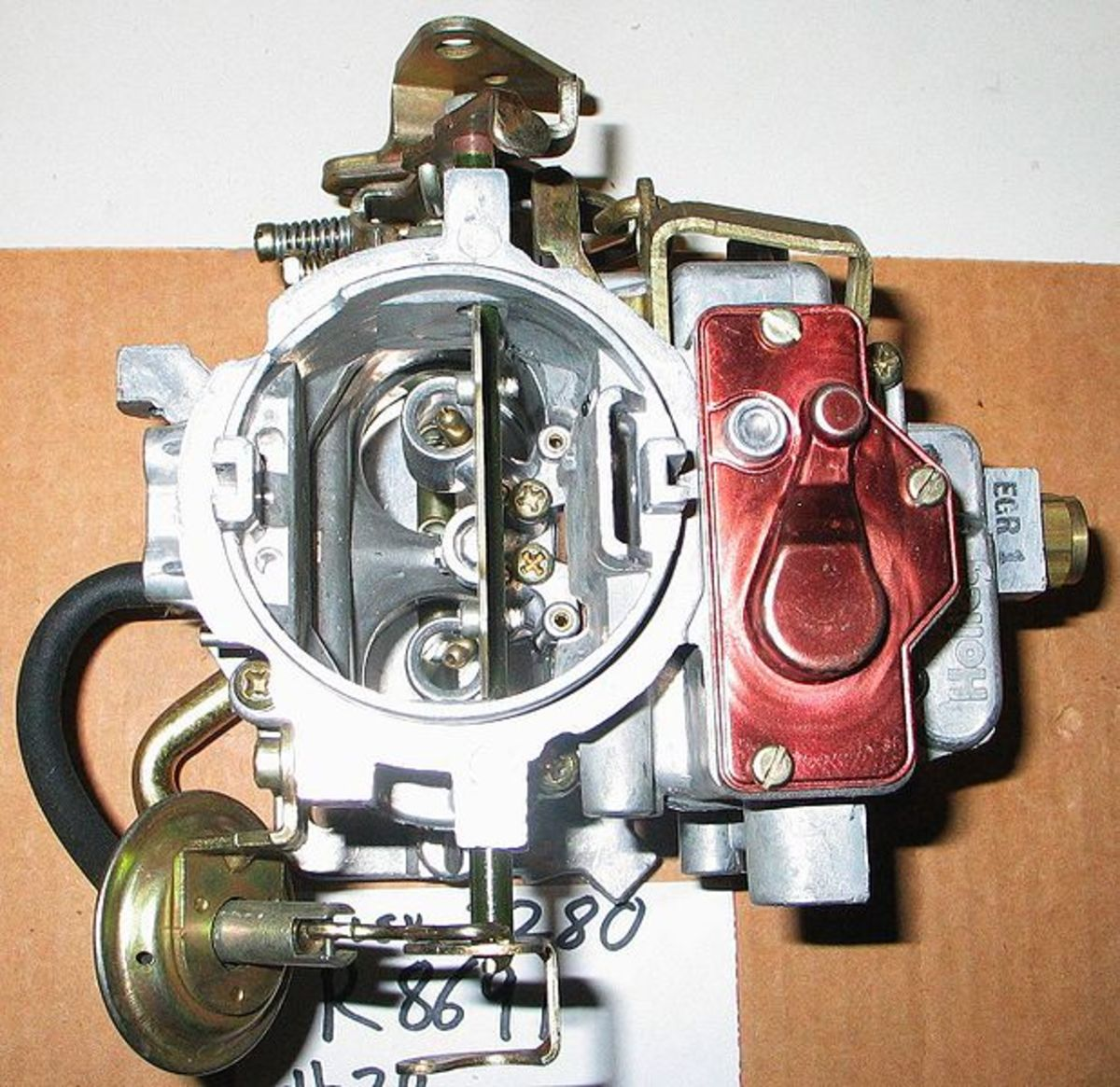 Remove carbon buildup from the throttle bore and valve.