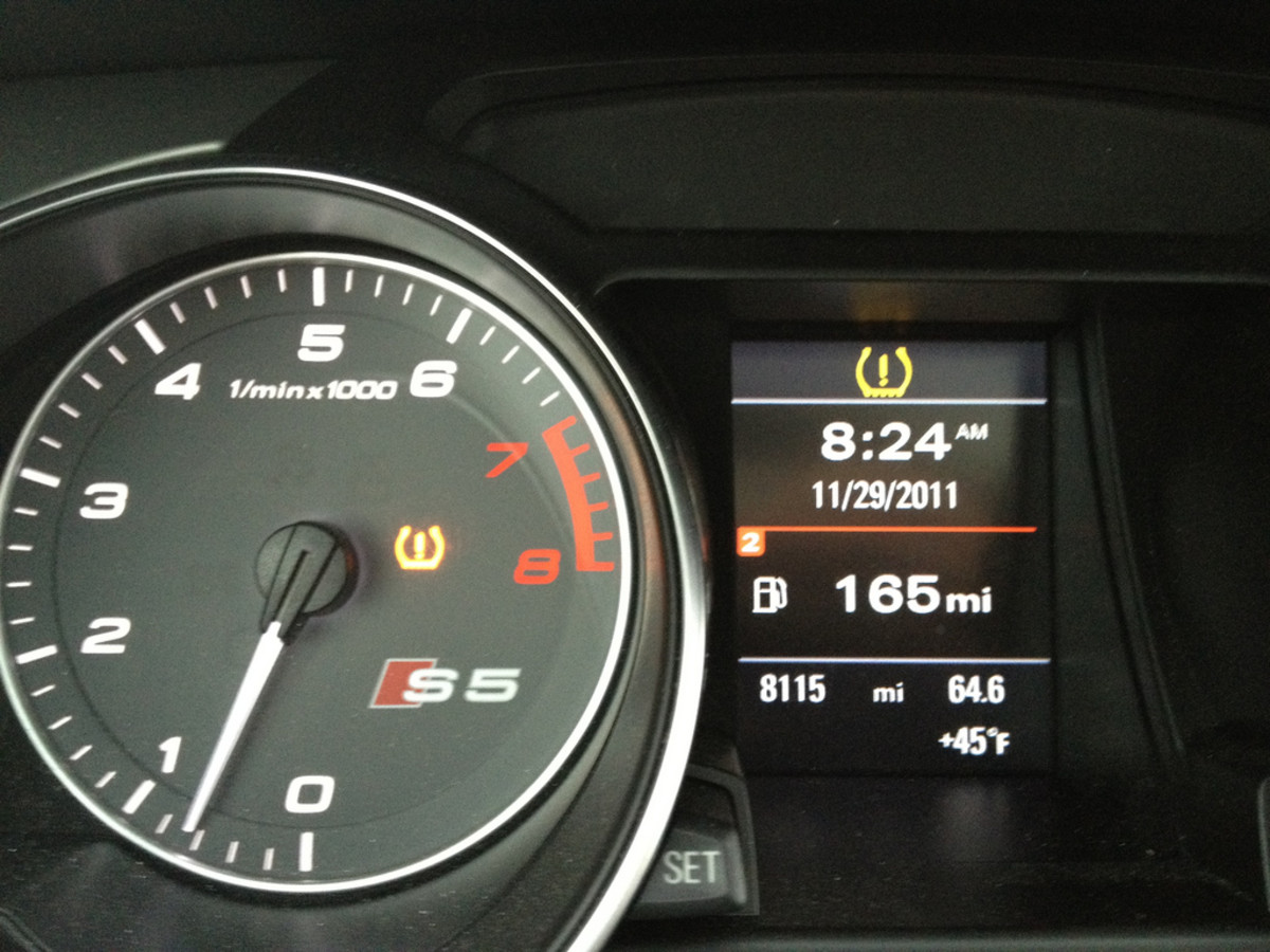 An Illuminated Low Tire Pressure Warning Light, or TPMS light, on a Typical Dashboard