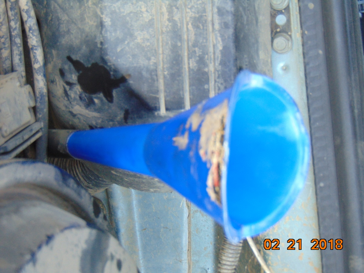 Put your funnel into the transmission fill hole and fill it with the appropriate amount and type of fluid.