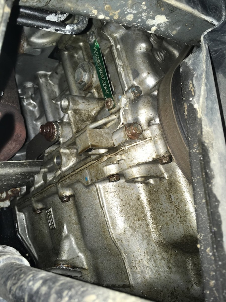 Leaking oil on the back side of the motor can smell like a gas leak when the engine gets hot.