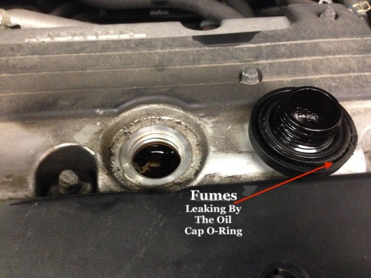 A missing oil cap can cause a huge mess and also cause a gas smell.