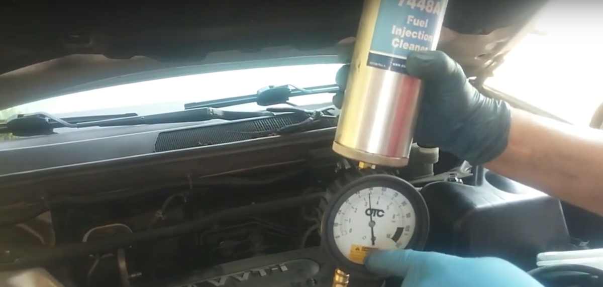 Using a pressurized container to inject fuel injection cleaning solution.