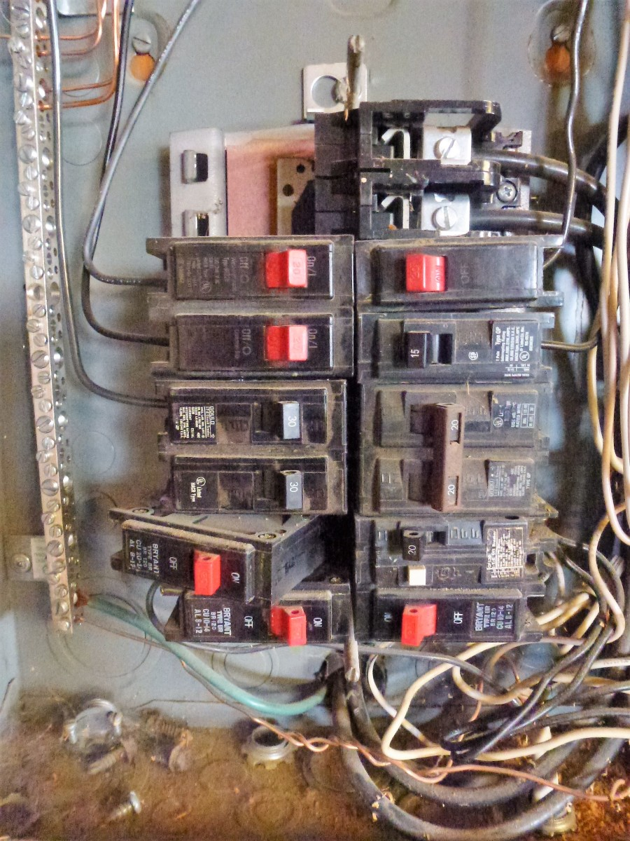 Installing a breaker.  The left side (nearest the edge of the panel) is hooked into the framework and it is being pushed down in the center.  It may take some force.