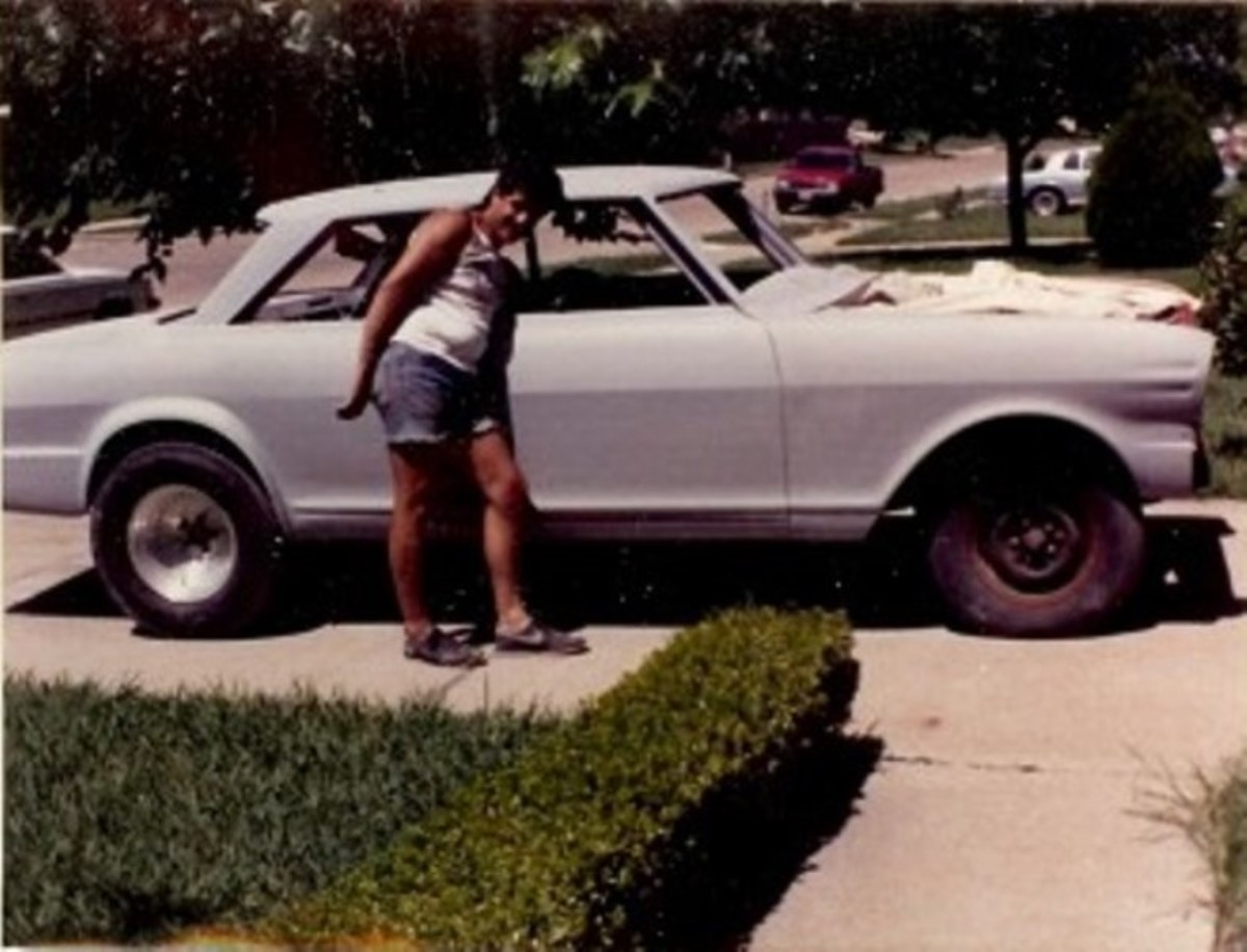 Jim next to the Nova after it was painted with primer and ready for paint.
