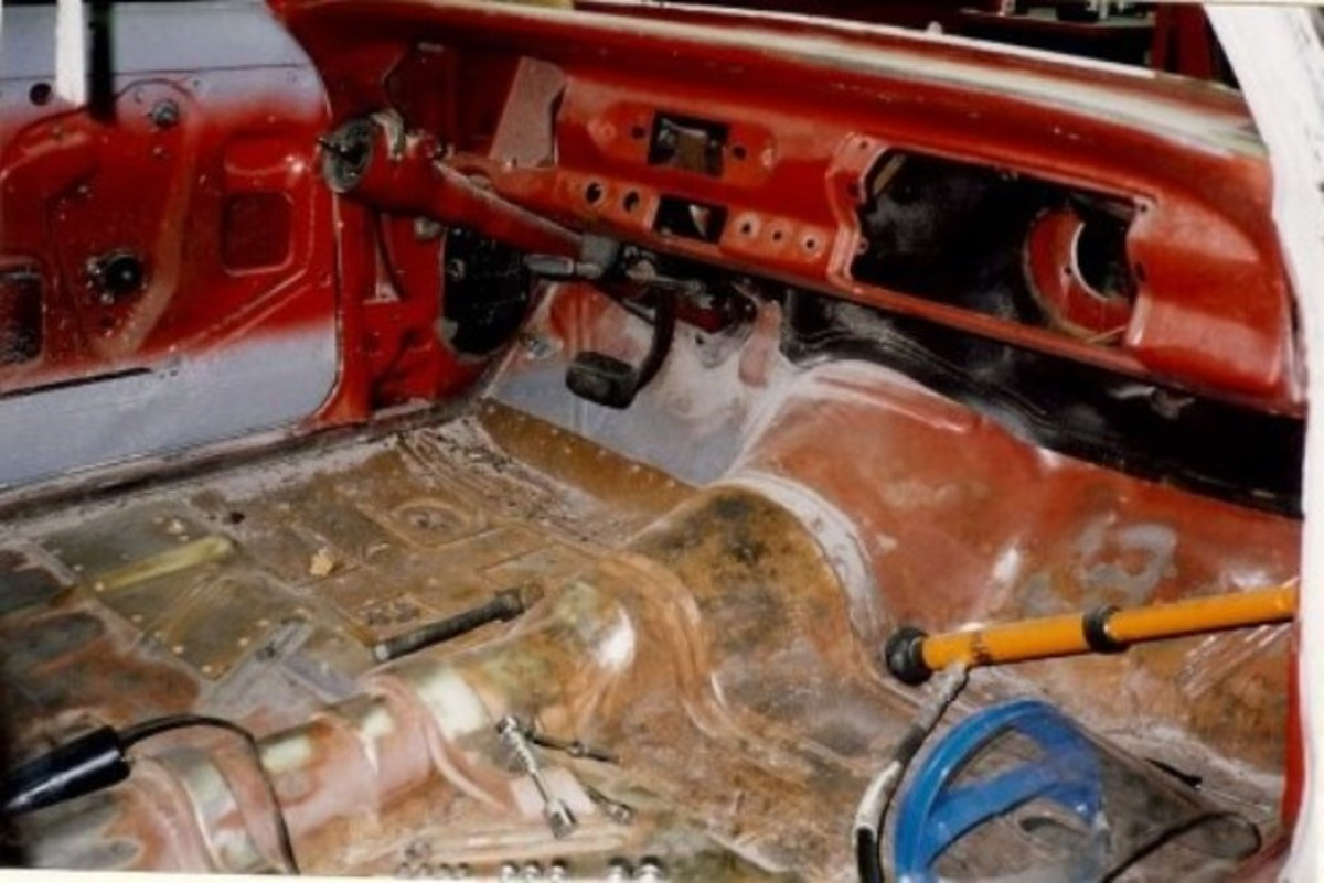 The interior of the Chevy Nova completely disassembled.