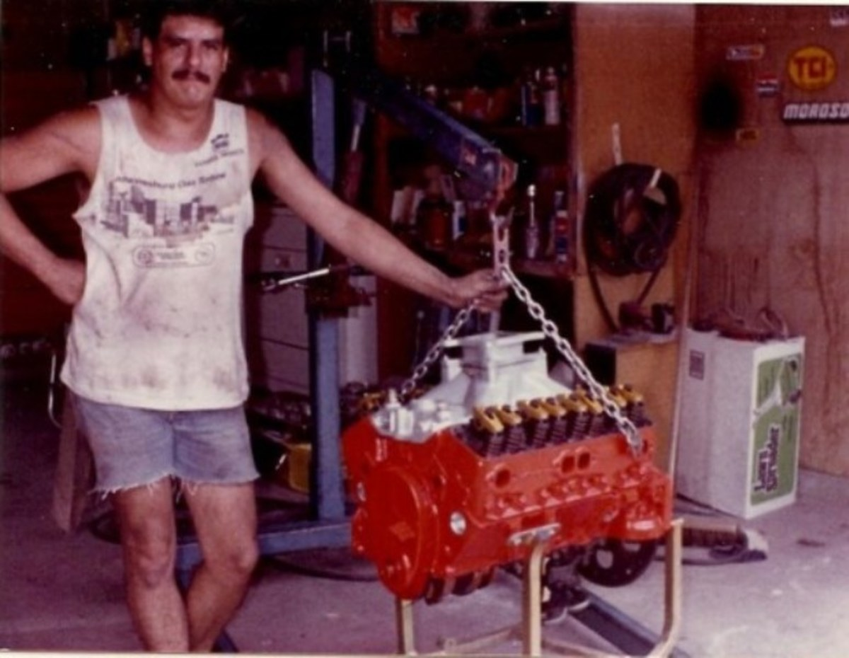 327 cubic inch small block Chevy engine ready to go into the engine compartment