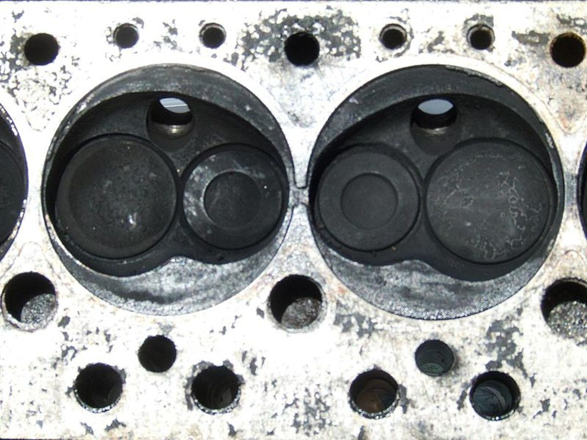 A blown head gasket may allow coolant into the cylinders and cause white smoke.