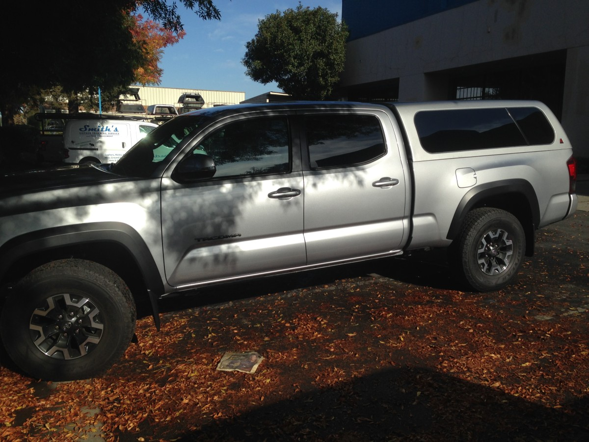 This is the Leer 100XL on a new Tacoma. The rear part of the glass wings open, or pops out.