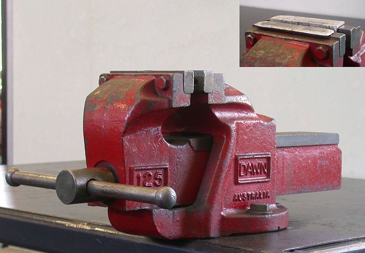 You can use a vise to better secure the master cylinder during the bench bleeding process.