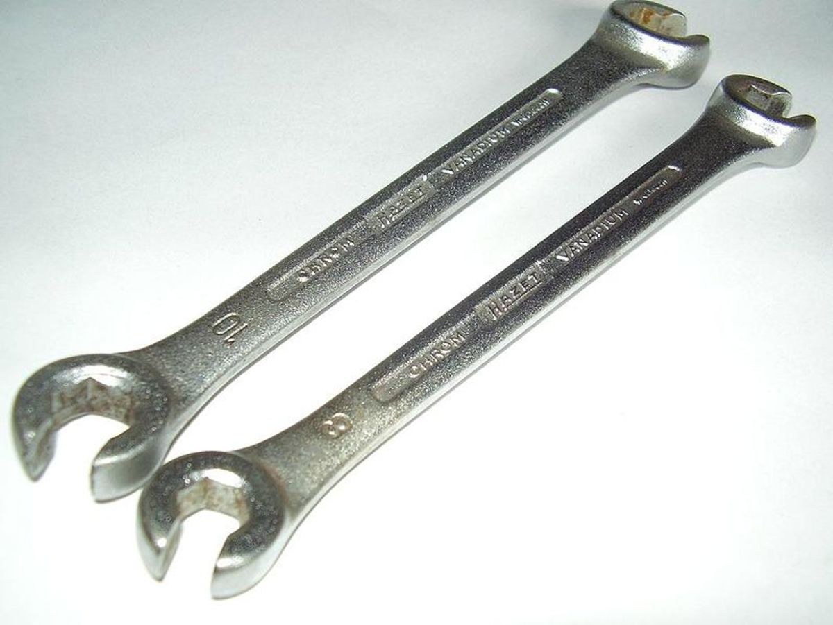 Use a line wrench to prevent rounding off brake line fasteners.