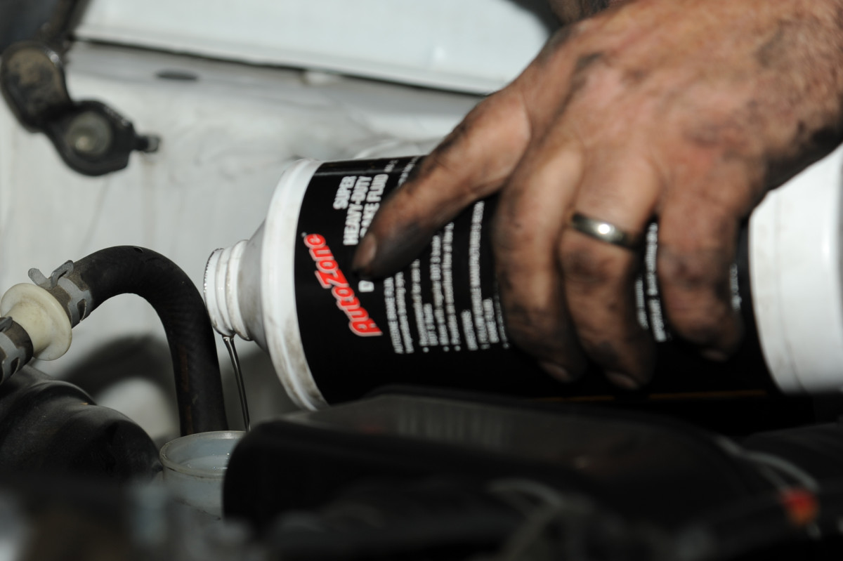 Use fresh brake fluid and the type recommended by your car manufacturer to reinstall the brake master cylinder.