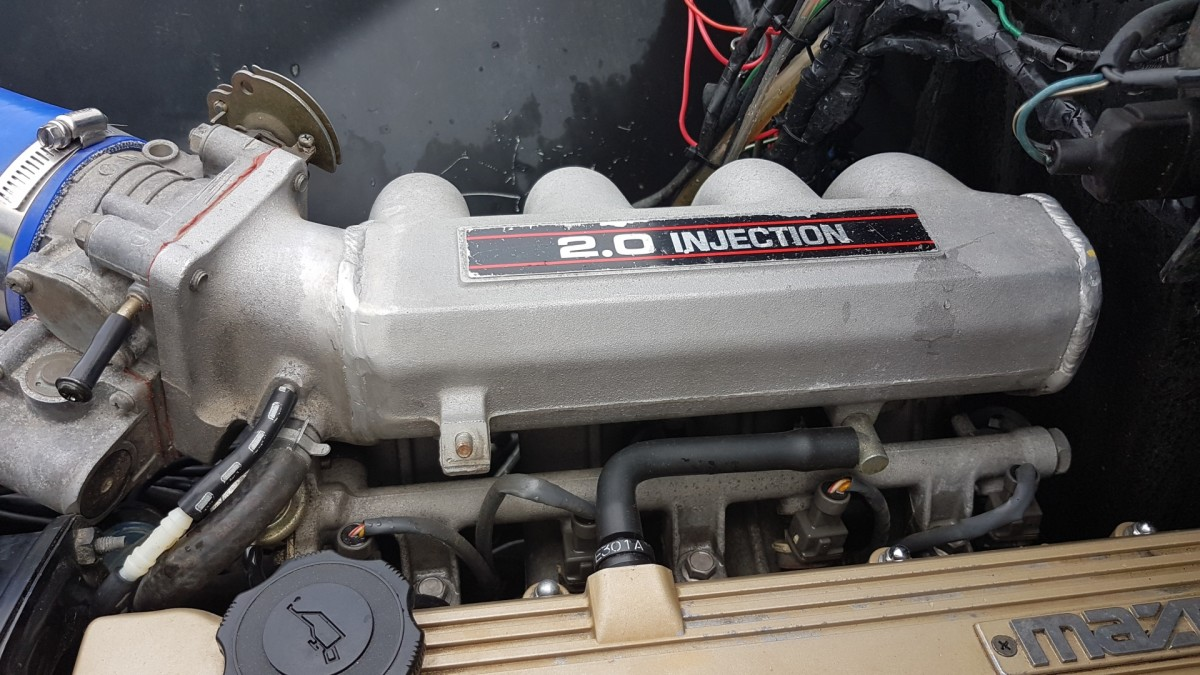 You can find the IAC attached to the throttle body, which connects to the intake manifold.