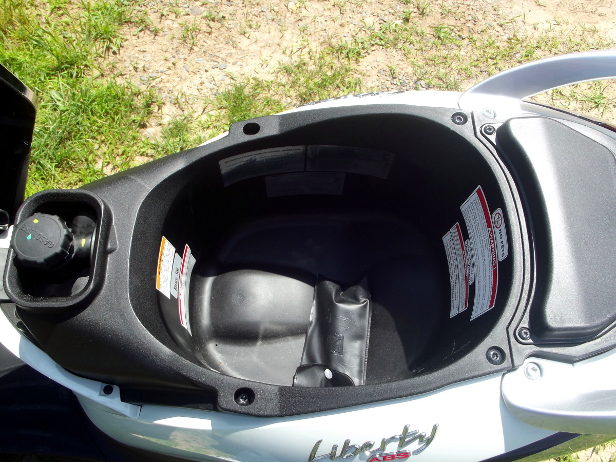 Storage beneath seat of Piaggio Liberty 150