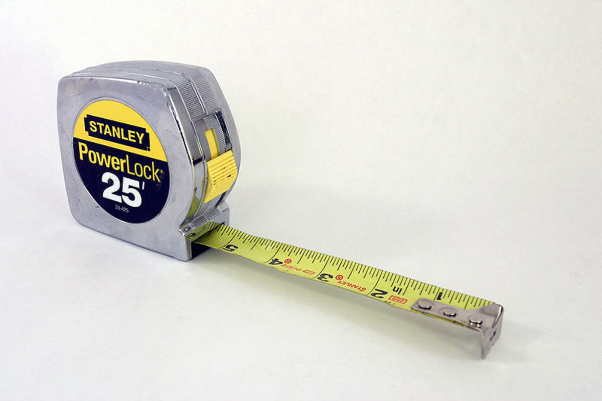 Use a regular tape measure or ruler to check clutch pedal free play.