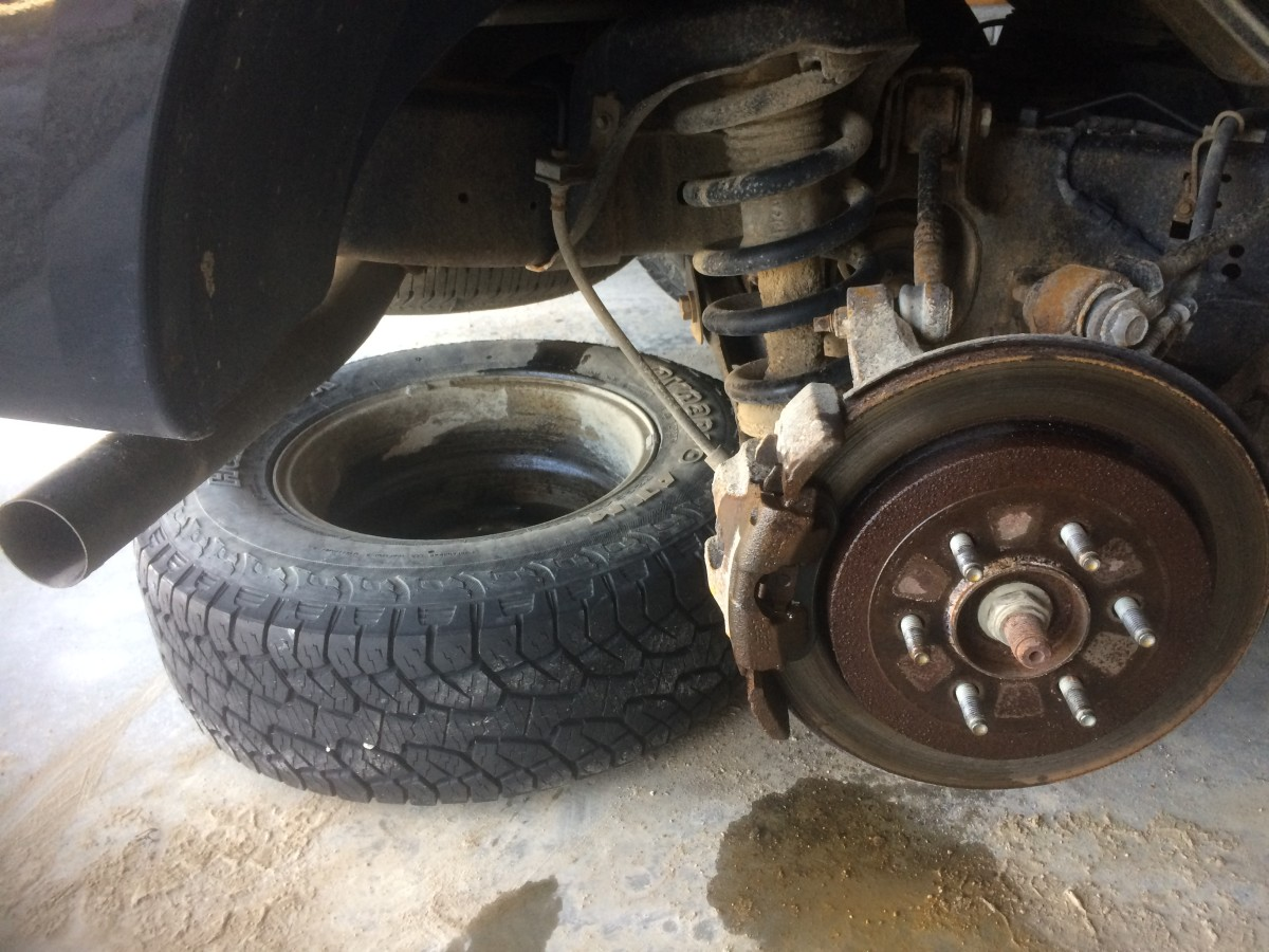A good safety tip is to use the old tire as a spacer—just in case your jack fails and the car drops down.