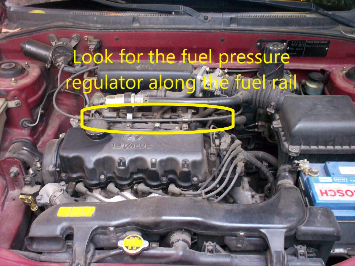 Look for the fuel pressure regulator in the fuel rail, near the fuel injectors.