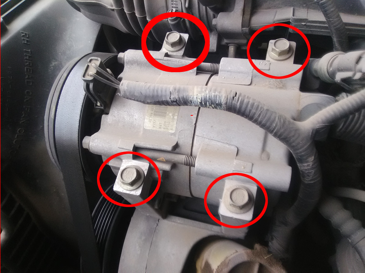 Check that AC-compressor mounting bolts are tight.