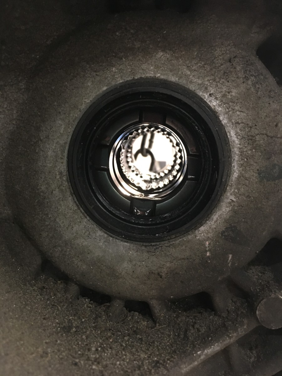 The little teeth in the center of the picture are the splines inside the transmission differential that mesh with the splines on the CV joint.