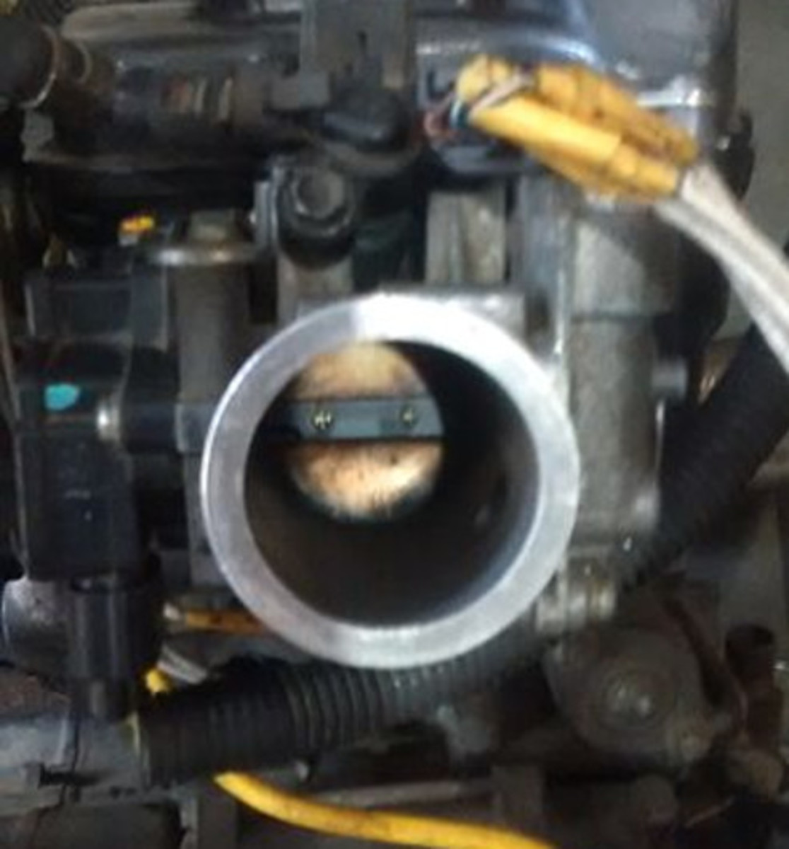 Check and remove buildup from the throttle body, if necessary.