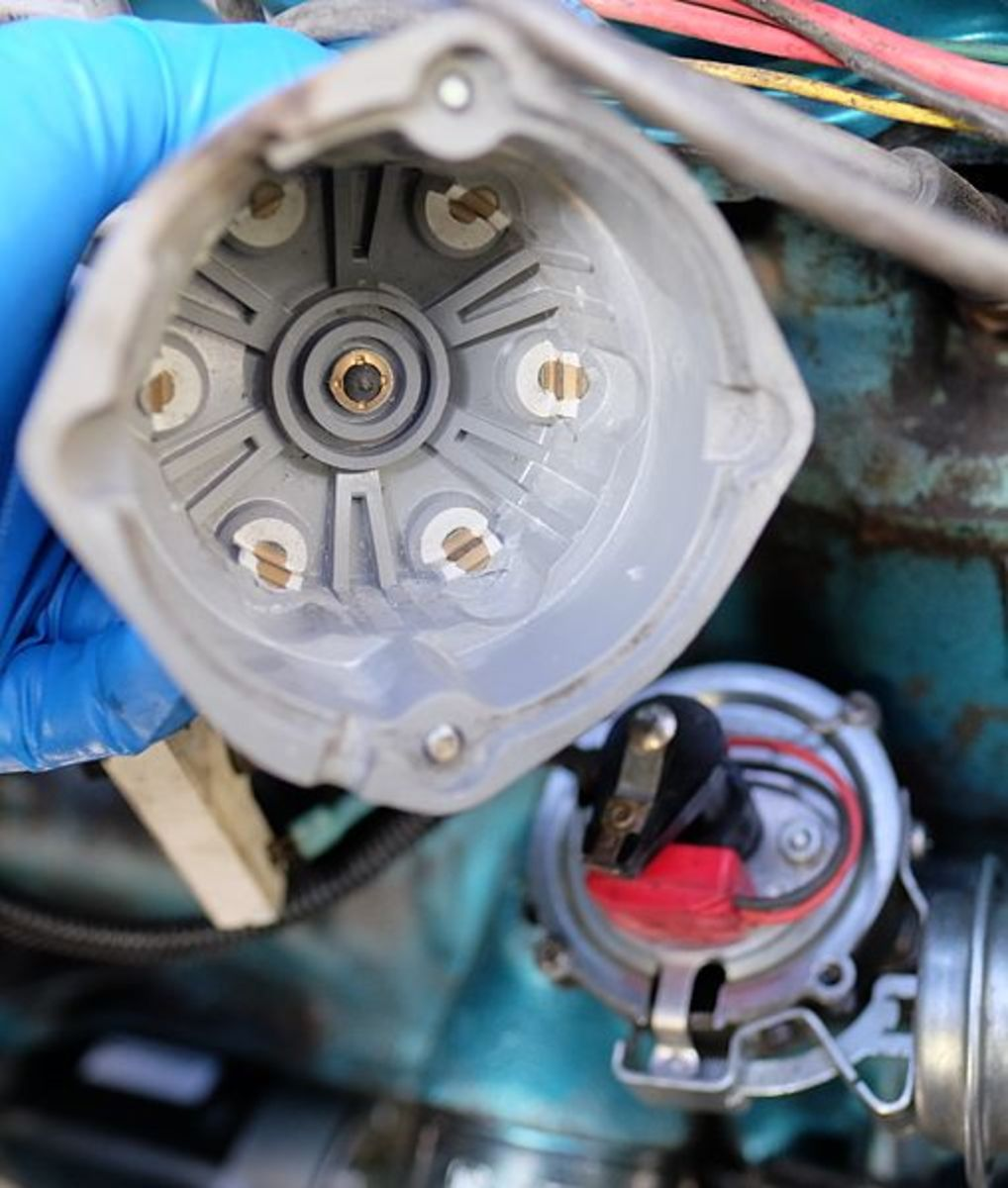 Carefully check the distributor cap's central and outer terminals and the rotor's tip.