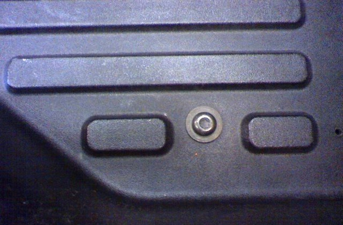 This is the body bolt in the bed toward the front that has to be removed.