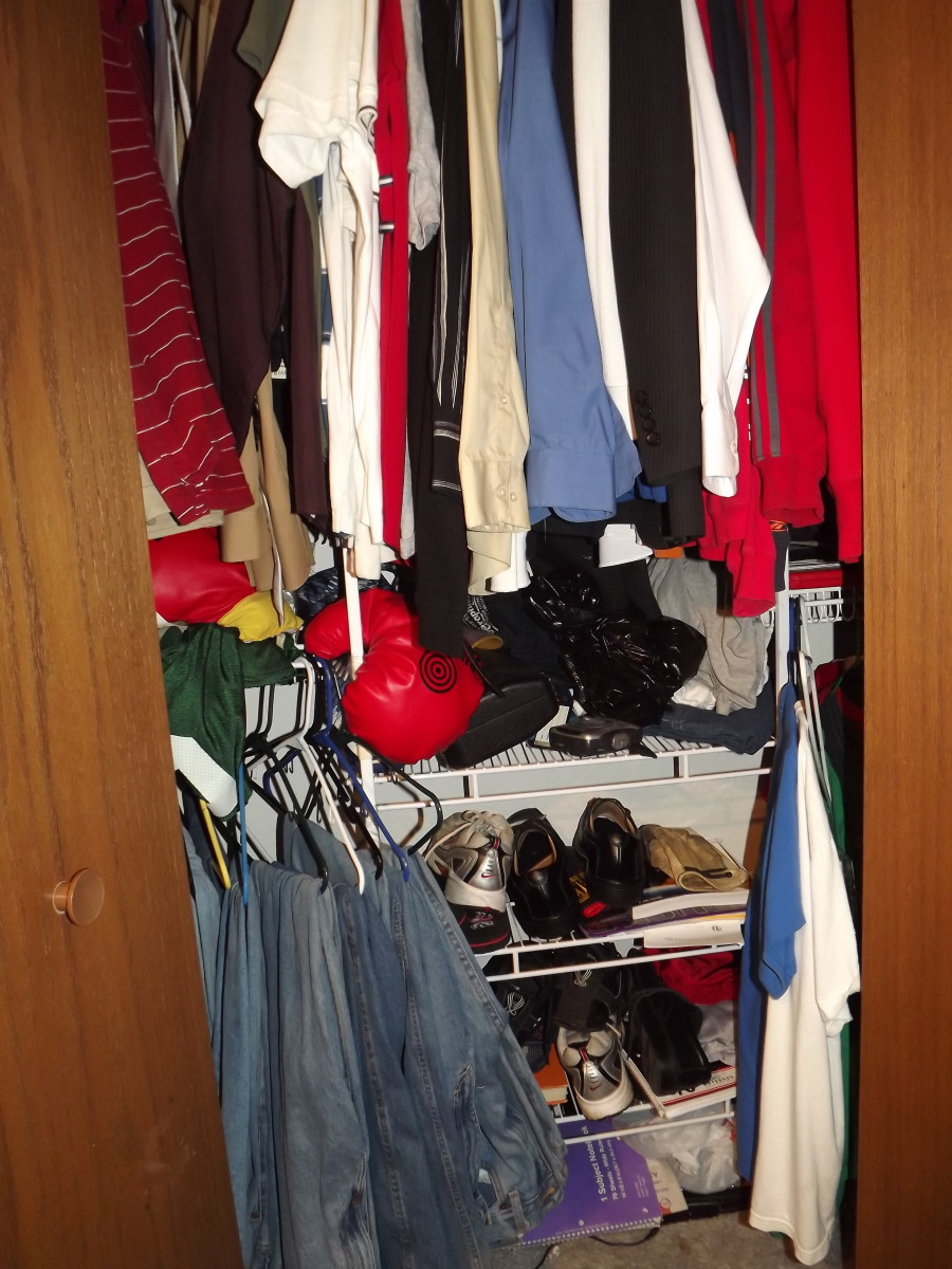 My fiance's messy closet. If you look you can see boxing gloves in there.