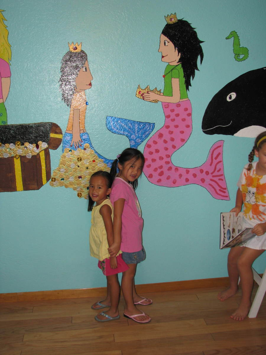 Little Mermaid Wall Mural: My oldest daughter designed this underwater mermaid mural for her three little sisters.
