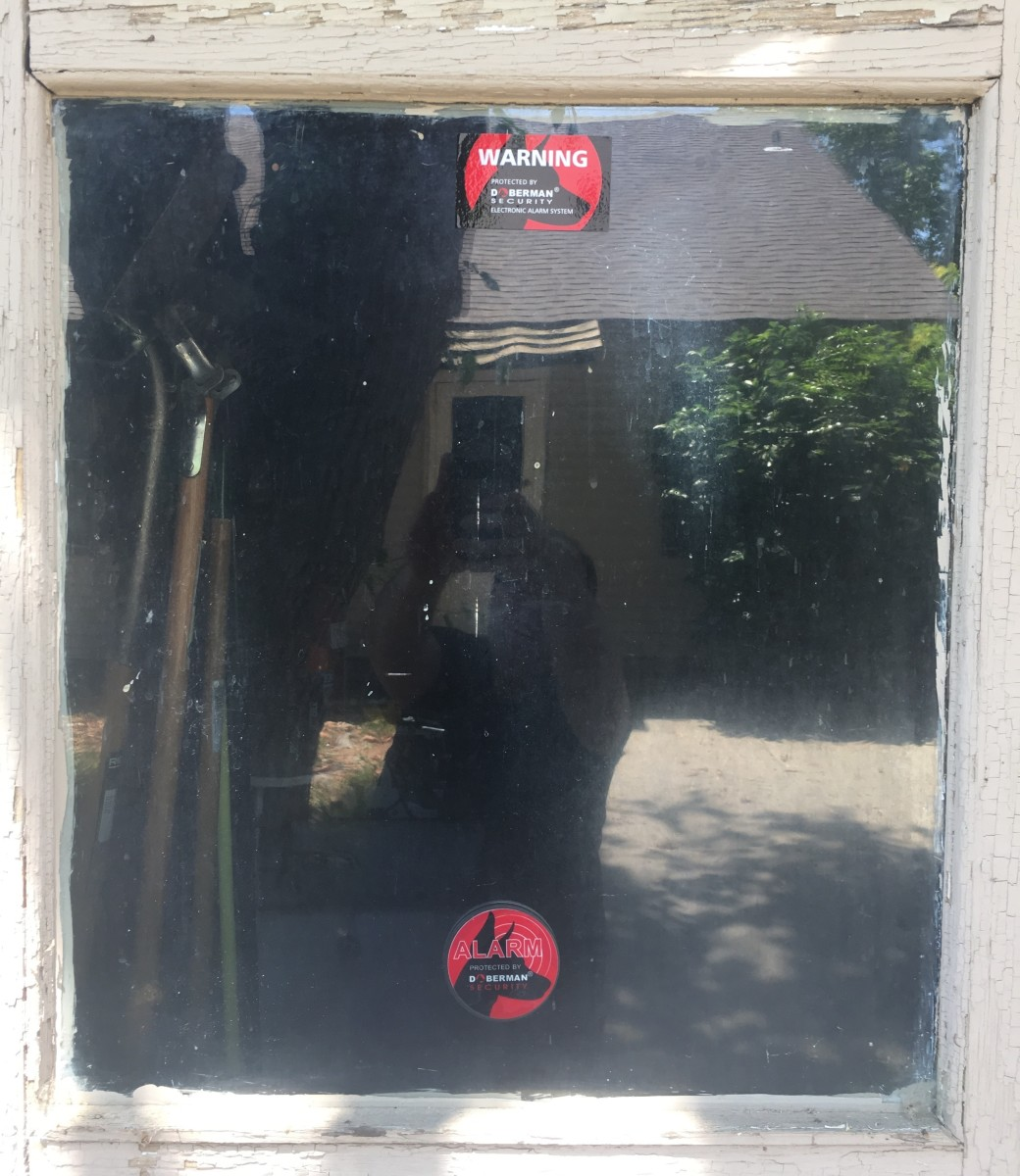 I use a Doberman Security alarm and sticker on my garage door since the garage is detached from my house.