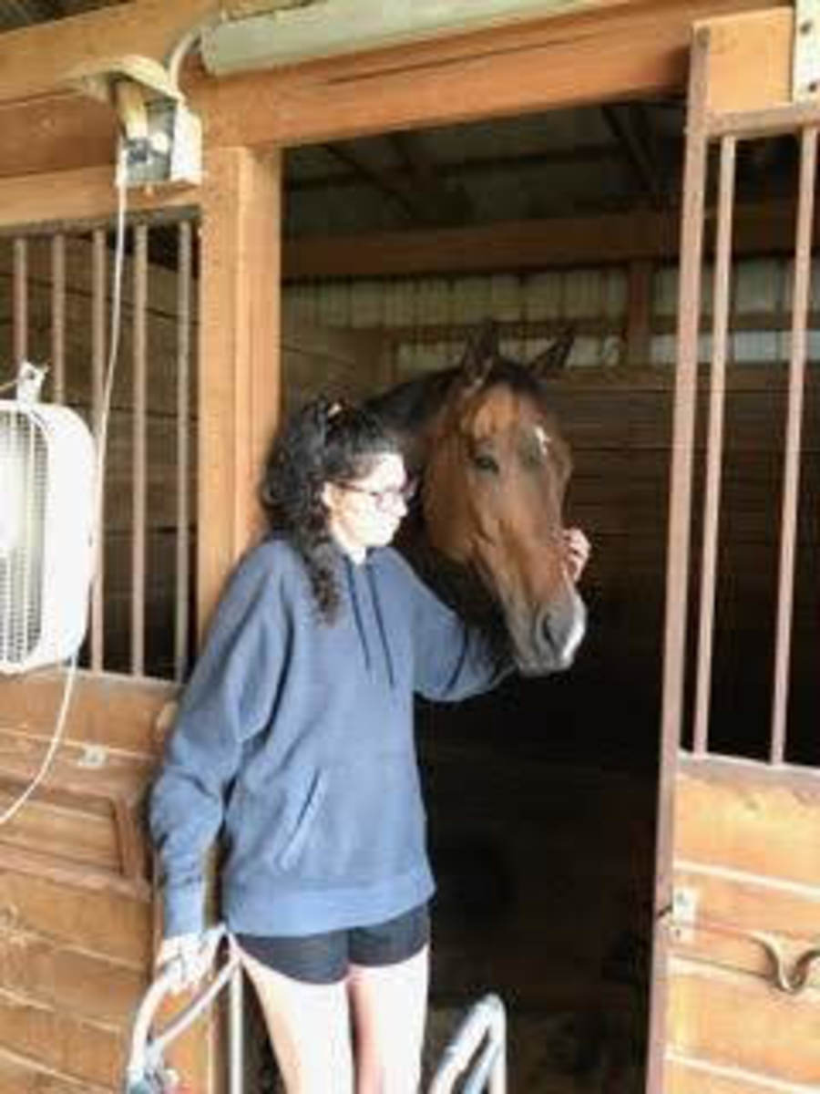 This picture was taken on July 13 (exactly three months after my accident) was the first time I made it back out in my barn. This is my main man, Kemerton and I. He is old and crippled now. It seems like now we relate more than ever!