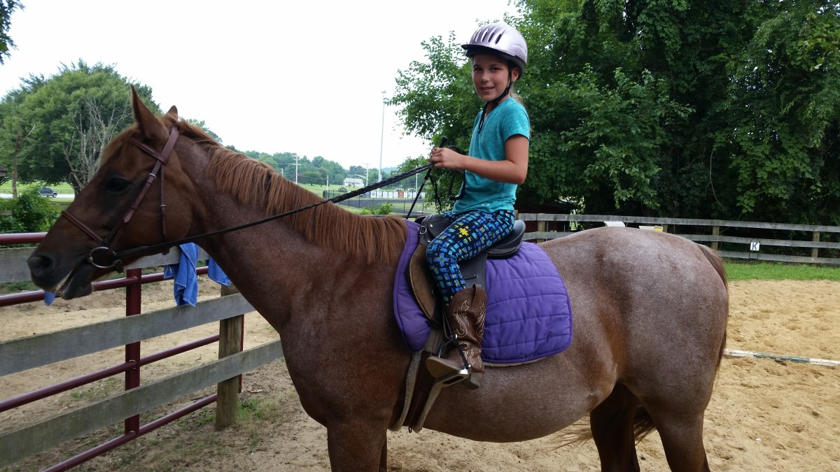 Example of boots that were not purchased in a tack store that work just fine for riding. I will say her feet are too far through the stirrups, though!
