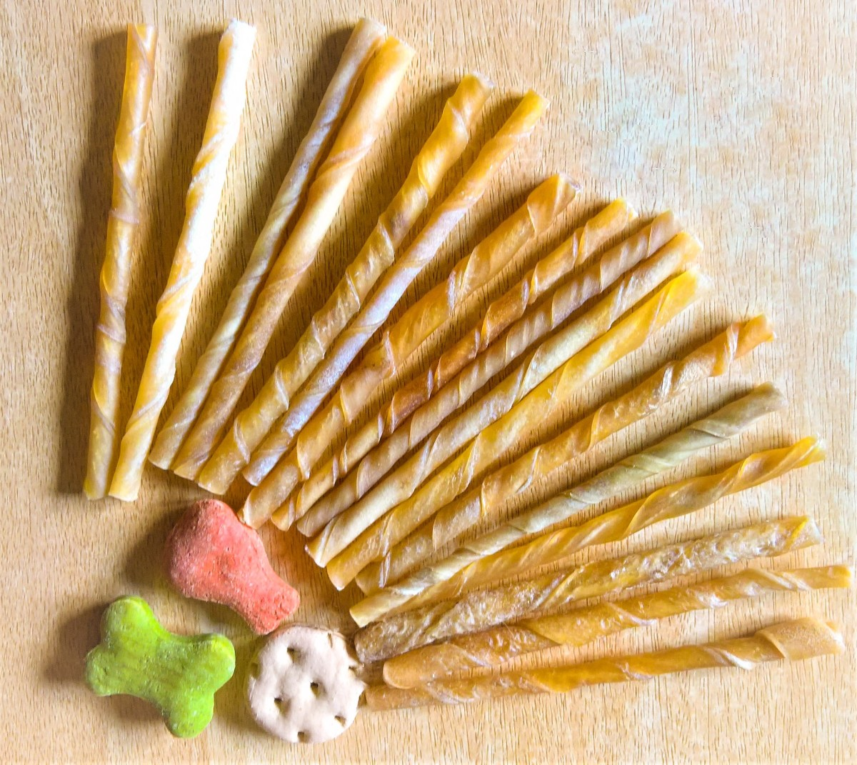 """Many vets advise against giving your dog bones because they may splinter and damage gums or cause choking. Manufactured """"chewy sticks"""" and dog cookies, like those shown above, are a safer option"""