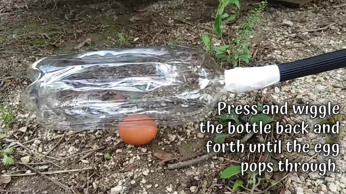 Press the bottle down on the egg and wiggle back and forth to grab it. This may take some practice!