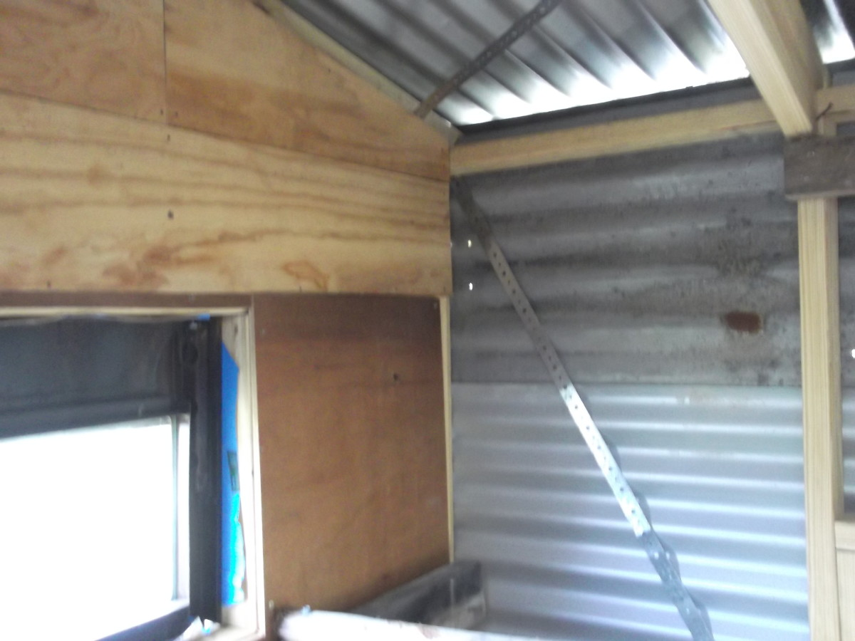 One wall insulated. Metal strapping provides additional strength for the structure in high winds.