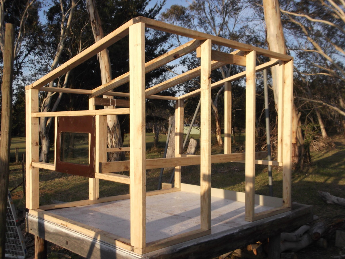 The frame of the hen house takes shape. We recycled one sheet of glass from an old oven door as a window. It is positioned at the height of the roosts, allowing us to check the chickens at night by shining a torch in.