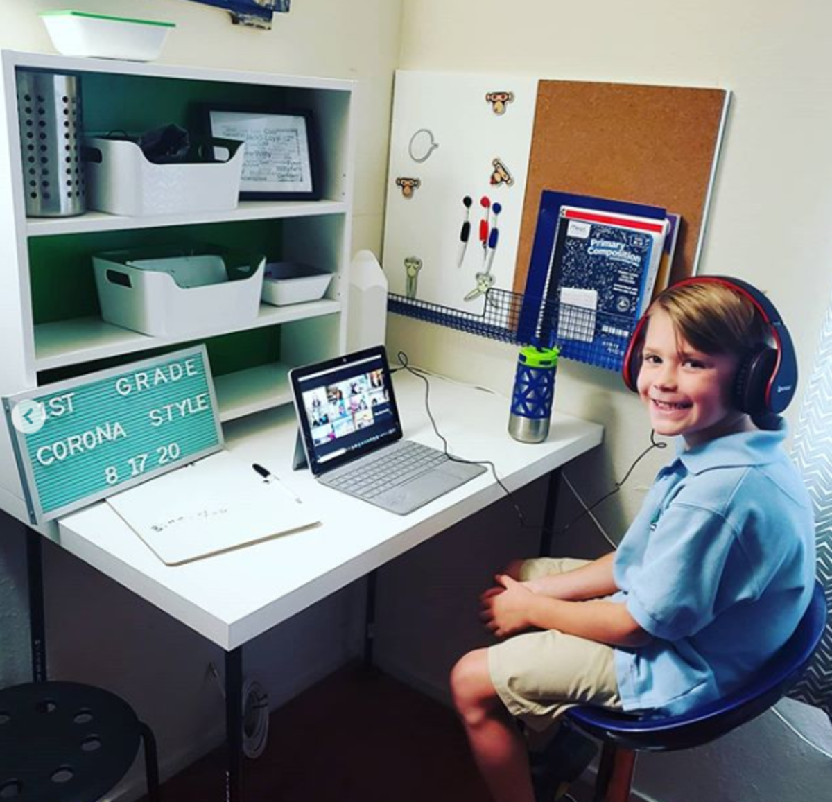 My nephew's home learning space, which includes a cork board, a white board, a letter board, and some storage bins.