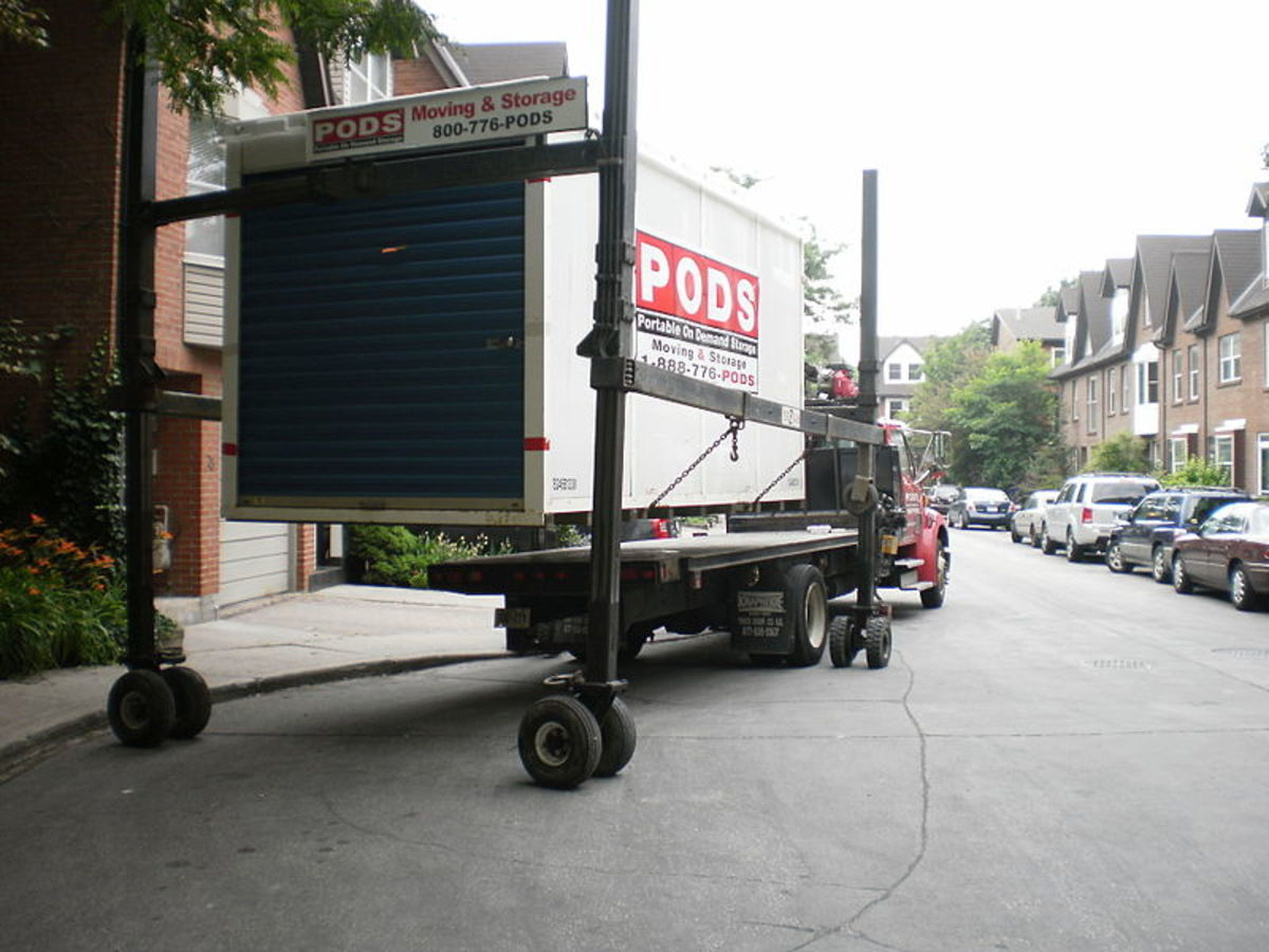 Unloading a shipping container with household contents