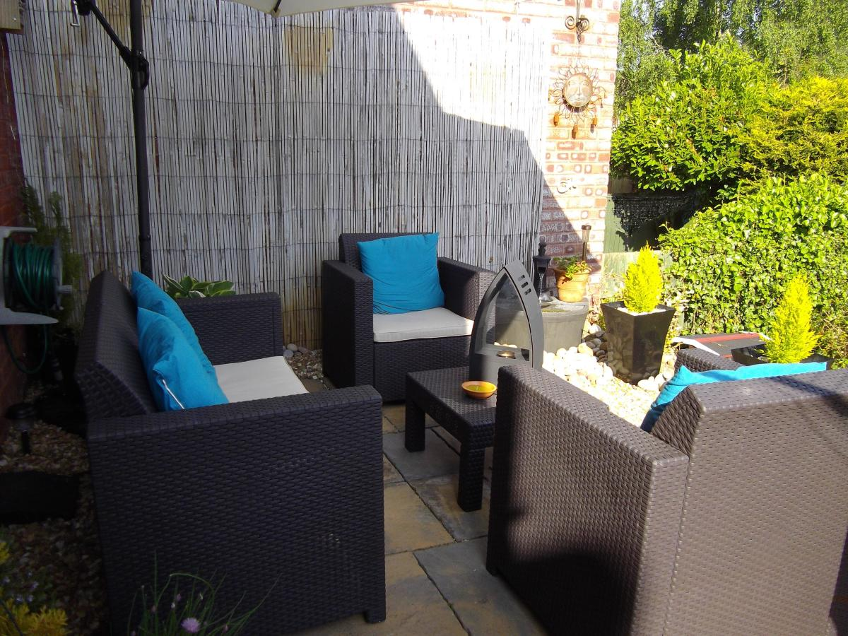 Outside sofa and chairs with waterproof cushions.