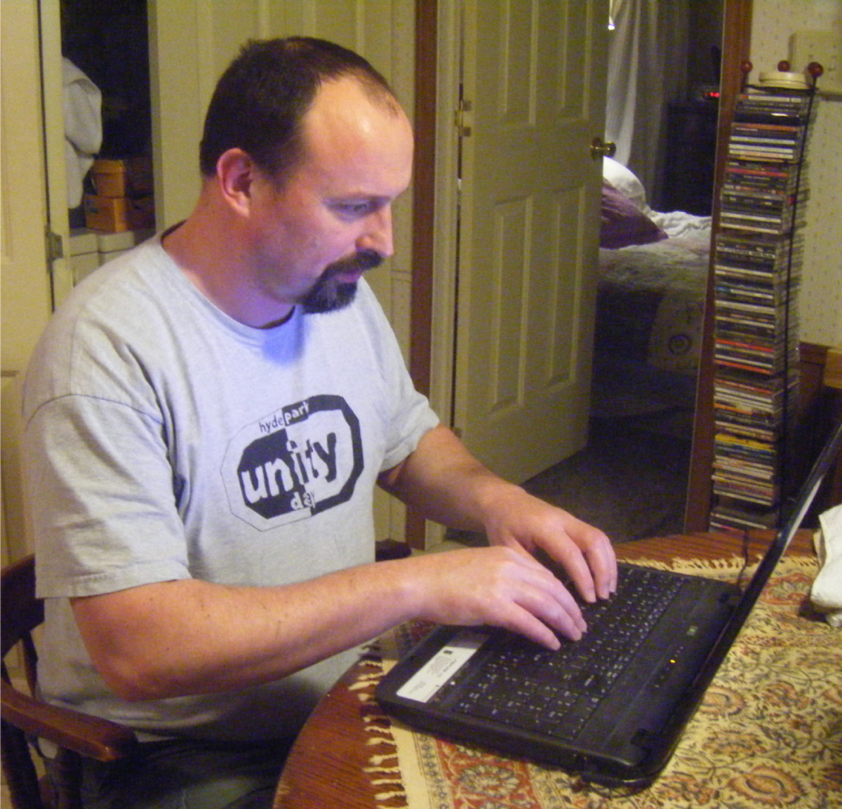 The writer at his computer.  MTurk can be more than a little confusing when you first begin, trying to assess the tasks and the job providers.