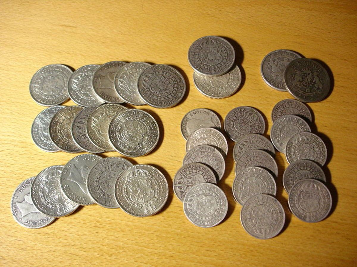 "Swedish one and two crown (""krona"") coins with 80% silver content"